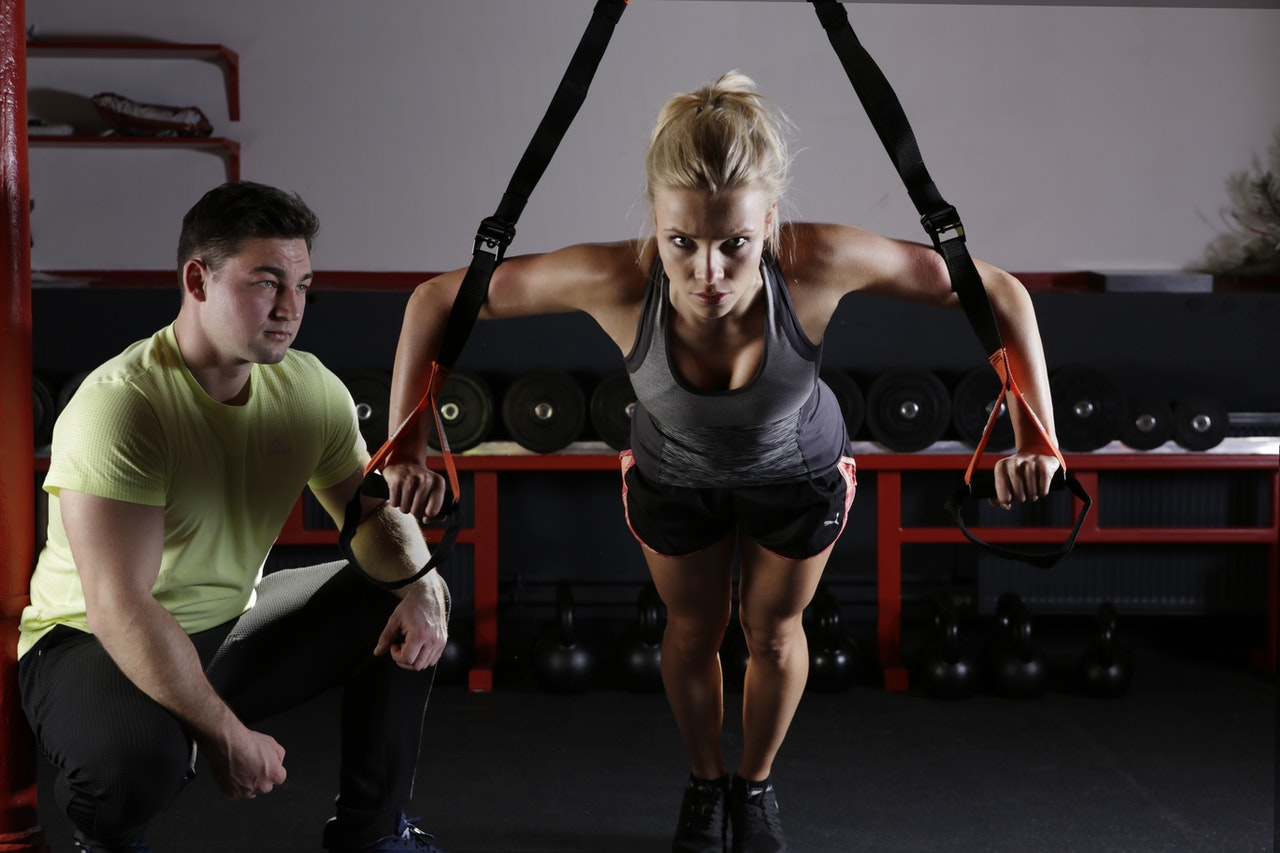 woman and a personal trainer