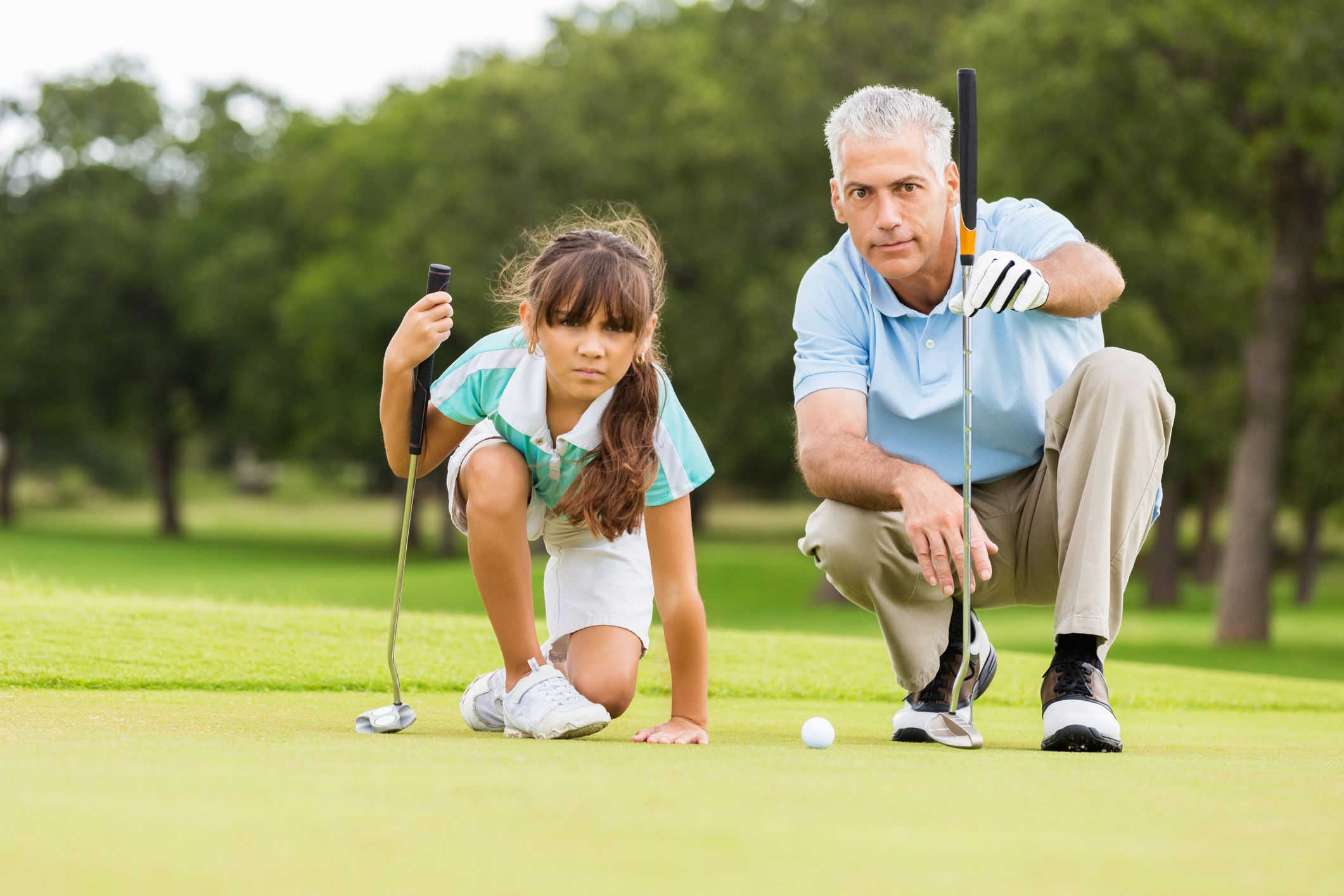 girl-and-man-golfing-5c244e1cc9e77c0001ace7be
