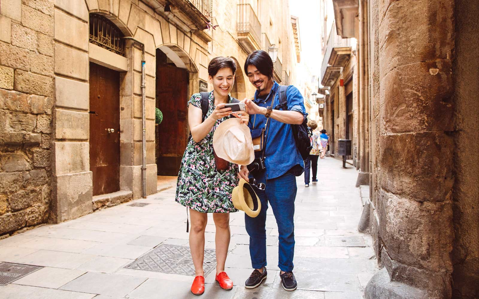 Couple using smartphone on the street