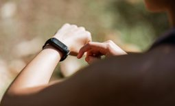 woman with fitness watch in nature